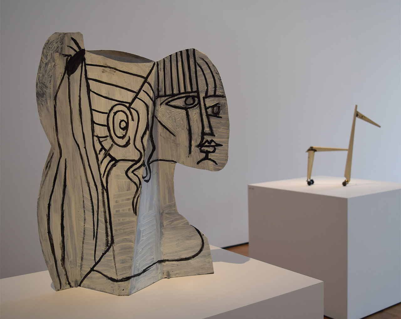 "Installation view of 'Picasso Sculpture' at the Museum of Modern Art with Pablo Picasso's ""Sylvette"" (1954) at left and ""Little Horse"" (1961) at right (all photos by the author for Hyperallergic)"