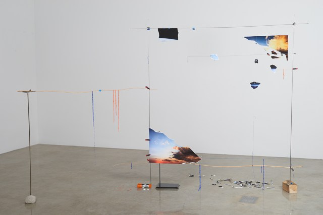 """Sarah Sze, """"Lost Image Standing (Fragment Series)"""" (2015), acrylic paint, archival prints, string, stainless steel, stone, wood, clamps, 72 1/2 x 109 x 41 in (184.2 x 276.9 x 104.1 cm) (photo by Brett Moen, courtesy the artist and Tanya Bonakdar Gallery, New York)"""