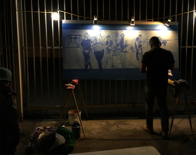 Artist Ray Vargas at work on a painting at 'Ambularte' mobile art exhibit in Boyle Heights, Los Angeles