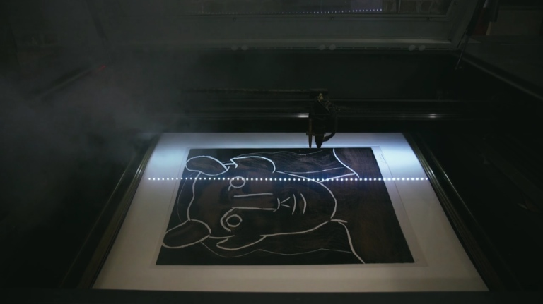 "Picasso underneath a laser (screenshot <a href=""https://vimeo.com/148548977"" target=""_blank"" srcset="