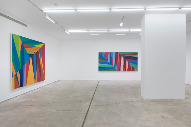 """Installation view, 'Odili Donald Odita: The Velocity of Change' at Jack Shainman Gallery, with """"The Door to Revolution"""" (2015) at left and """"Chasm"""" (2015) at right (click to enlarge)"""