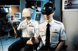 Tech. Sgt. William Lexa and Senior Airman Raymond Pettit conduct virtual reality research at Brooks Air Force Base, Texas. (photo via Wikimedia Commons) (click to enlarge)