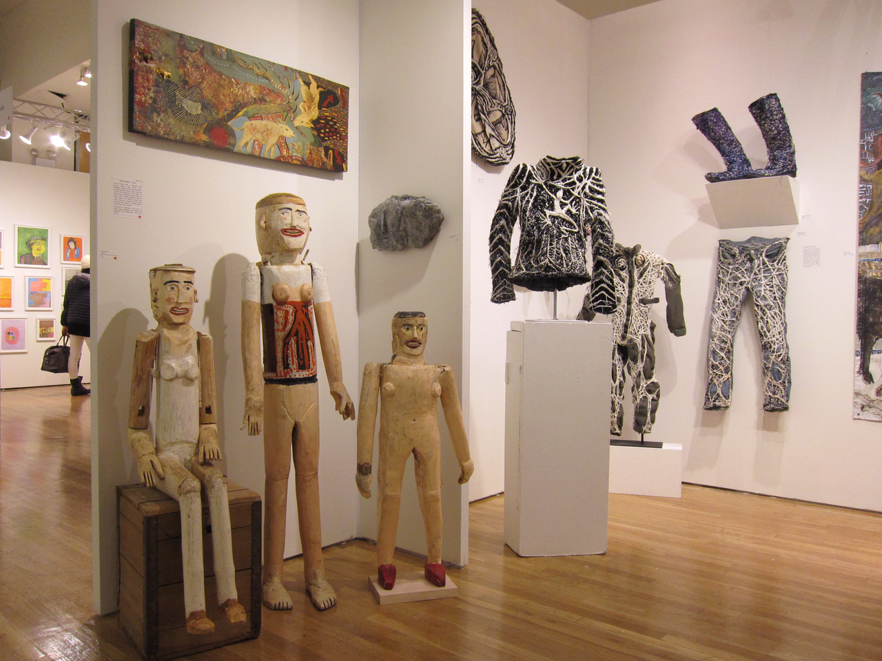 Figural sculptures by John VanZile and clothing works by Robert Adele Davis at American Primitive