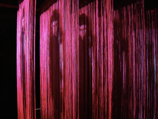 YOU BELONG TO ME 2015 Audio/video installation 1 projector and 5 rows of pink fringe in a wooden or steel frame suspended from the ceiling 6' x 3' x 8', 6:30 looped