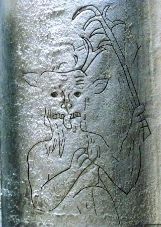 A medieval demon with a flesh hook in St Mary's church, Beachamwell, Norfolk