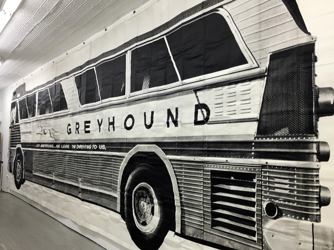 A LifeSize 1967 Photograph of a Greyhound Bus Drives into