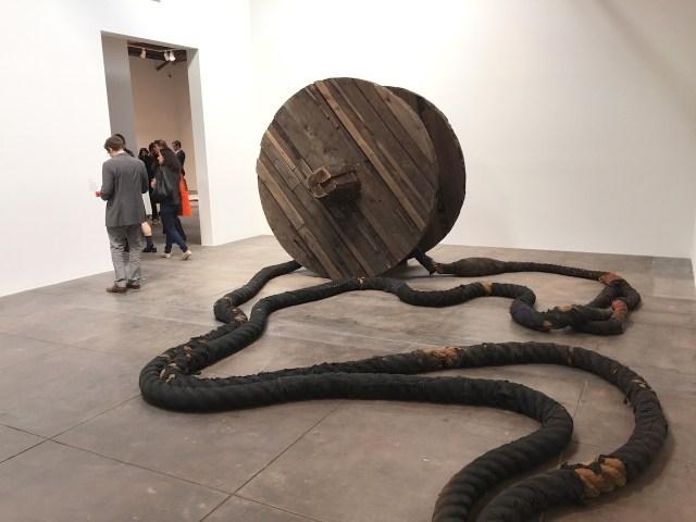 "Magdalena Abakanowicz, ""Wheel and Rope"" (1973), Wood, burlap, hemp, metal line, 2 wheels, each: 7ft x 8 1/8 in. (diameter), 2 ropes, each approx. 190 ft."