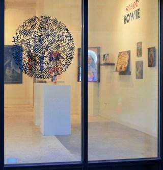 "'Saint Bowie' installation view with Barry William Hale ""BlackStar"" (2016), cut vinyl on window"