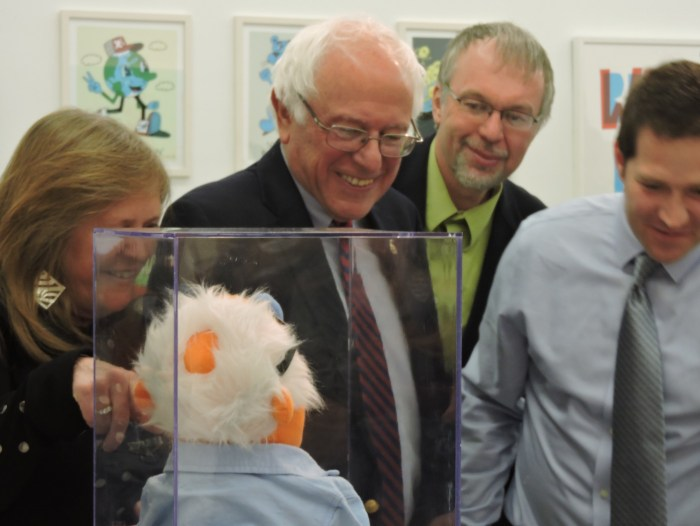 Bernie laugs at Dan Muller's untitled art work of him as a Muppet (image by author for Hyperallergic)