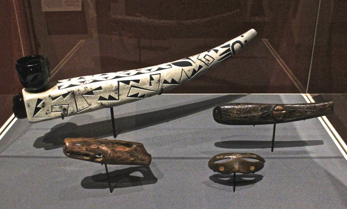 """Top left: Tammy Garcia and Preston Singletary, """"Ivory Pipe"""" (2010), blown and etched glass, on display with 2nd- to 5th-century walrus ivory from the Bering Strait region"""