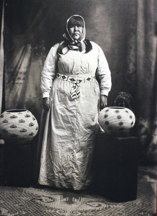 Image of Washoe basketmaker Louisa Keyser (also known as Datsolalee) beside some of her trademark designs (click to enlarge)