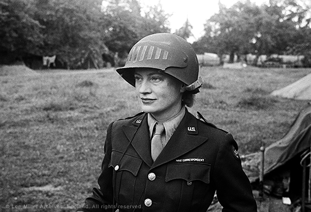 Lee Miller in steel helmet specially designed for using a camera, Normandy, France, 1944, by unknown photographer (© The Penrose Collection, England 2015)