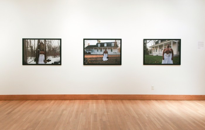 Installation view of Nona Faustine's photographs from her White Shoes series
