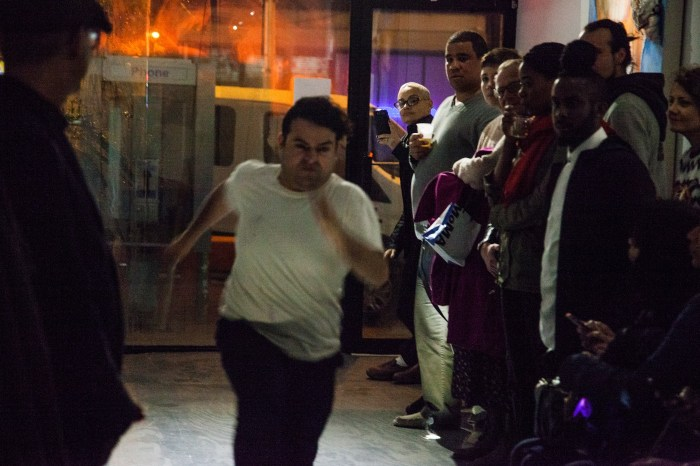 Geraldo Mercado running through the gallery at Performance Anxiety. Photo by Gregory Paul
