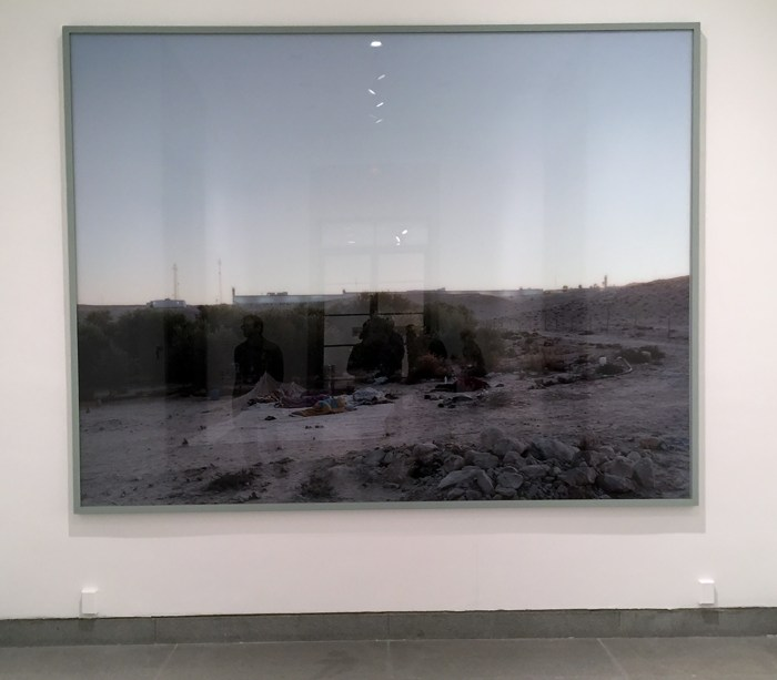Jeff Wall's large photograph greets visits to the This Place exhibition at the Brooklyn Museum.