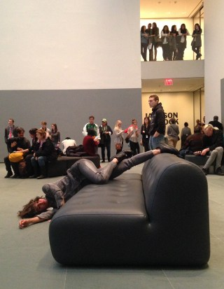 A dancer performing Maria Hassabi's 'PLASTIC' at MoMA in March (photo by the author for Hyperallergic)