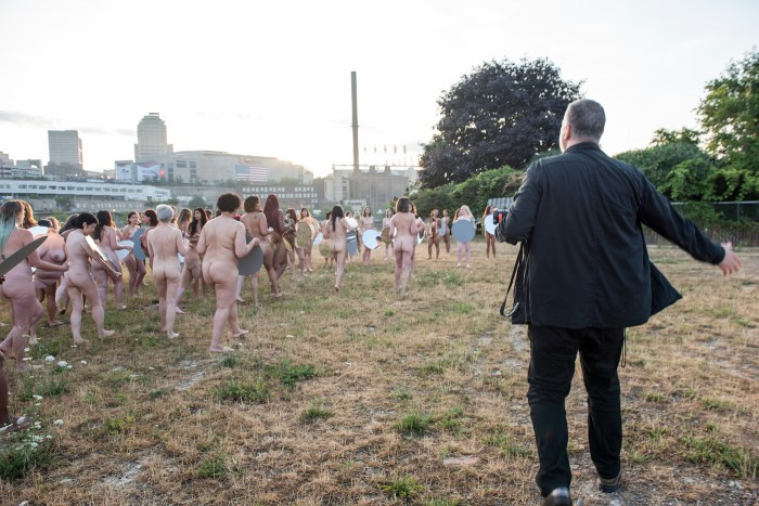 """Spencer Tunick shooting """"Everything She Says Means Everything"""" (2016) in Cleveland (photo by Lindsey Byrnes, courtesy the artist)"""