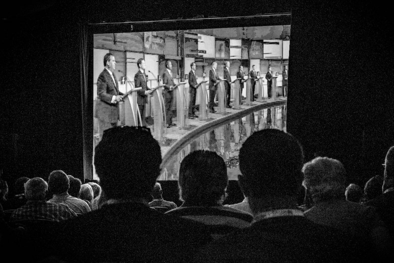 """Mark Peterson, """"Attendees at the RedState Gathering watch the first 2016 Republican presidential debate, which took place in Cleveland, Ohio, Atlanta, GA"""" (August 6, 2016) (© Mark Peterson/Redux Pictures)"""