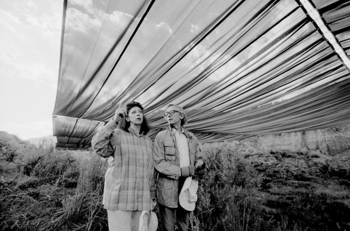 "Christo and Jeanne-Claude during the life-size test for ""Over The River,"" summer 1999 (photo by Wolfgang Volz, © 1999 Christo)"