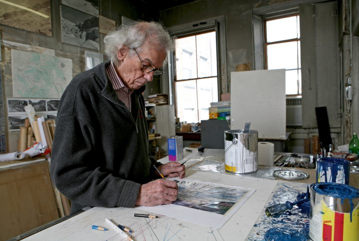 """Christo in his studio working on a preparatory collage for """"Over The River"""" in 2011 (photo by Wolfgang Volz, © 2011 Christo)"""