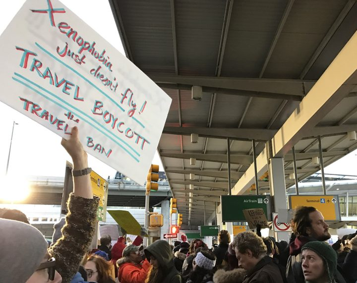 Protesters at New York's JFK Airport following the passage of President Trump's first travel ban (photo by Jillian Steinhauer/Hyperallergic)