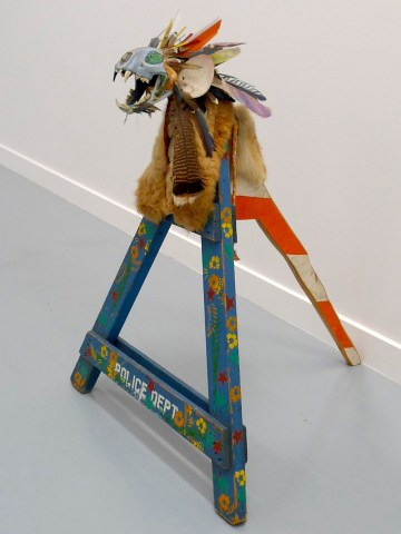 """Jimmie Durham, """"Tlunh Datsi"""" (1984), puma skull, shells, turquoise, turkey feathers, metal, sheep and deer fur, pine, acrylic paint, 40 1/2 x 35 3/4 x 31 3/4 in, private collection, Belgium"""