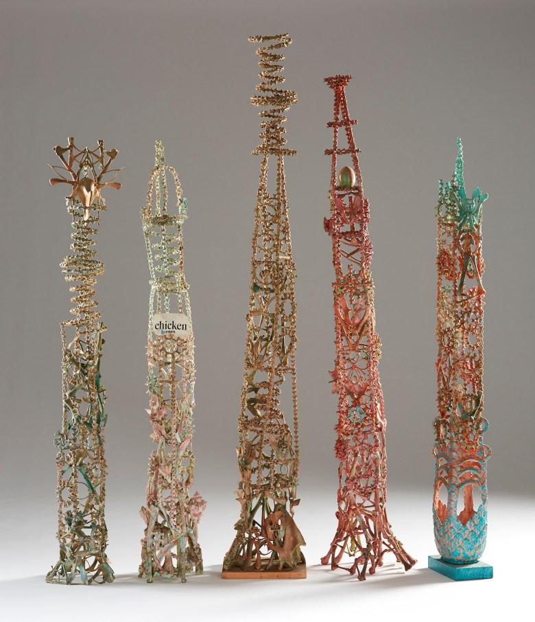 """Eugene Von Bruenchenhein, """"untitled (bone tower)"""" (1970–80), fowl bones, paint, glue, varnish, 44 x 8 x 6 5/8 inches; """"Untitled (bone tower)"""" (1970–80), fowl bones, paint, glue, wire, seashells, 43 3/4 x 6 3/4 x 7 inches; """"Untitled (bone tower)"""" (1970–80), fowl bones, paint, glue, 54 x 8 3/8 x 7 1/4 inches; """"Untitled (bone tower)"""" (1970–80), fowl bones, paint, varnish, egg shells, 49 3/4 x 9 1/4 x 9 3/4 in. Untitled (bone tower), c. 1970–80; fowl bones, paint, glue, clay, wood; 44 x 6 3/4 x 5 1/2 inches (courtesy John Michael Kohler Arts Center Collection, photo by Rich Maciejewski)"""