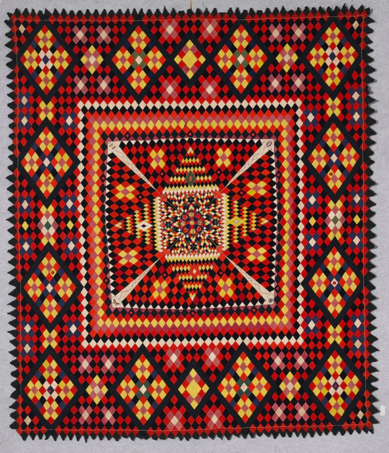 Artist unidentified, Anglo-Zulu War Army Quilt (South Africa or United Kingdom, late 19th century), wool from military uniforms, with embroidery thread; hand-embroidered, with pointed and pinked edges, 86 5/8 x 74 7/8 inches (courtesy the Annette Gero Collection, photo by Tim Connolly, Shoot Studios)