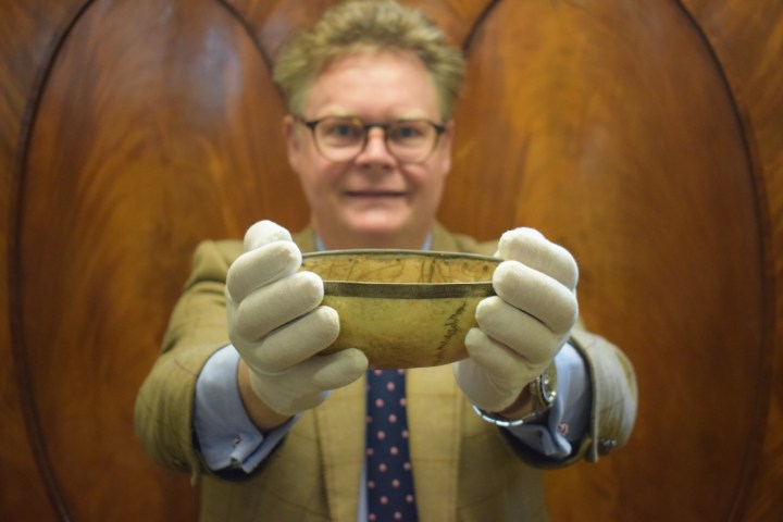 Auctioneer Richard Bromell with the skull drinking cup associated with Lord Byron (courtesy Charterhouse Auctioneers and Valuers)