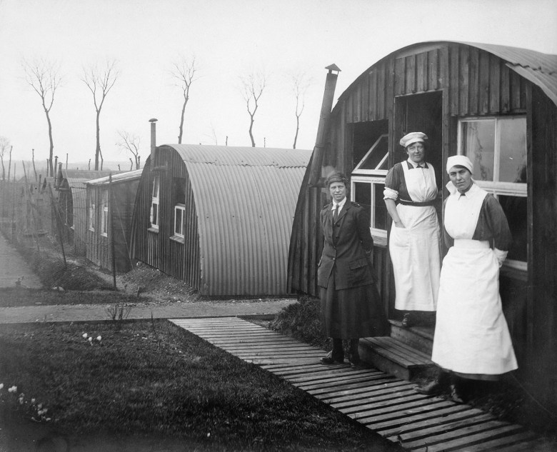 """Olive Edis, """"Commandant Johnson and two other women of the General Service Voluntary Aid Detachment (VAD) Motor Convoy outside Nissen Huts, Abbeville, France"""" (1919) (© IWM (Q 8036))"""