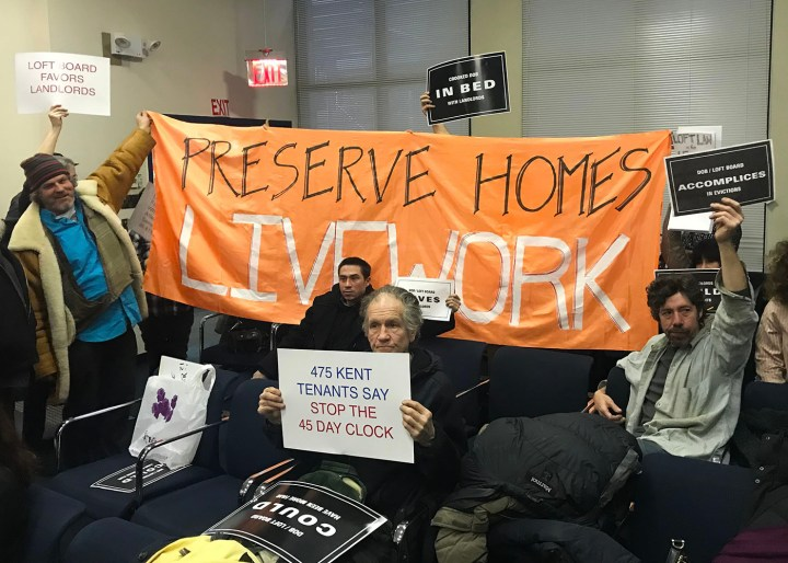 Protesters at a public meeting of New York City's Loft Board on January 18, 2018 unfurled a banner after the meeting concluded. (all photos by the author for Hyperallergic)