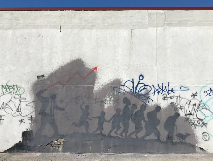 The larger of Banksy's two Midwood murals as it appeared on March 24, 2018, partially obscured by gray paint