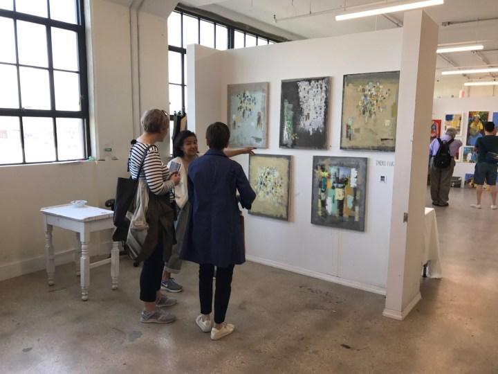 Artist Taeko Kuraya speaks to visitors in her studio (all images courtesy Trestle)