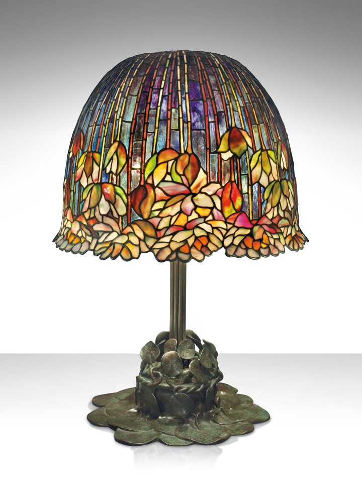 """Tiffany Studios, a rare and important """"Pond Lily"""" table lamp (c. 1903), leaded glass, patinated bronze, 26 1/2 inches high, 18 inches diameter of shade (image courtesy Christie's)"""