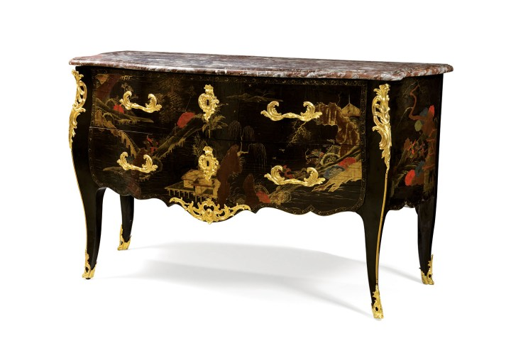 "A Louis XV Chinese lacquer and European varnish gilt-bronze mounted commode, (c. 1750), attributed to Jacques Dubois, opening with two drawers, the Flemish marble top, with a label ""Château de Divonne"" (image courtesy Sotheby's)"