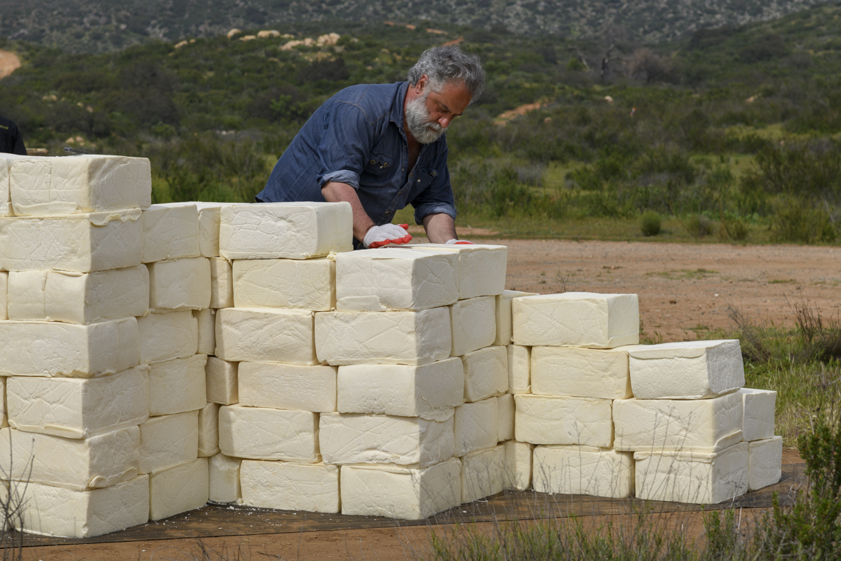 """Artist Sues Trump's Border Wall Contractors for Destroying His """"Cheese Wall"""""""