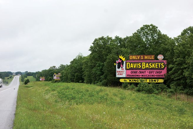 Davis's billboards are distinctive. If you don't catch all the writing as you speed down the highway, don't worry. Another one will soon come in view