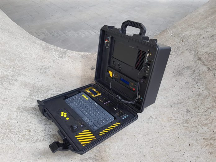 a military looking cyberdeck with a built in geiger counter hyperedge embed image