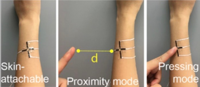 An image of the e-skin sensor being worn and testing out its distance and touch sensing ability.