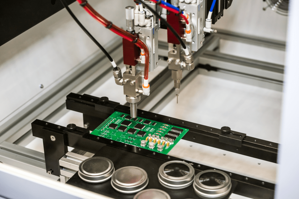 Application of conformal coating by a flexible robotic machine