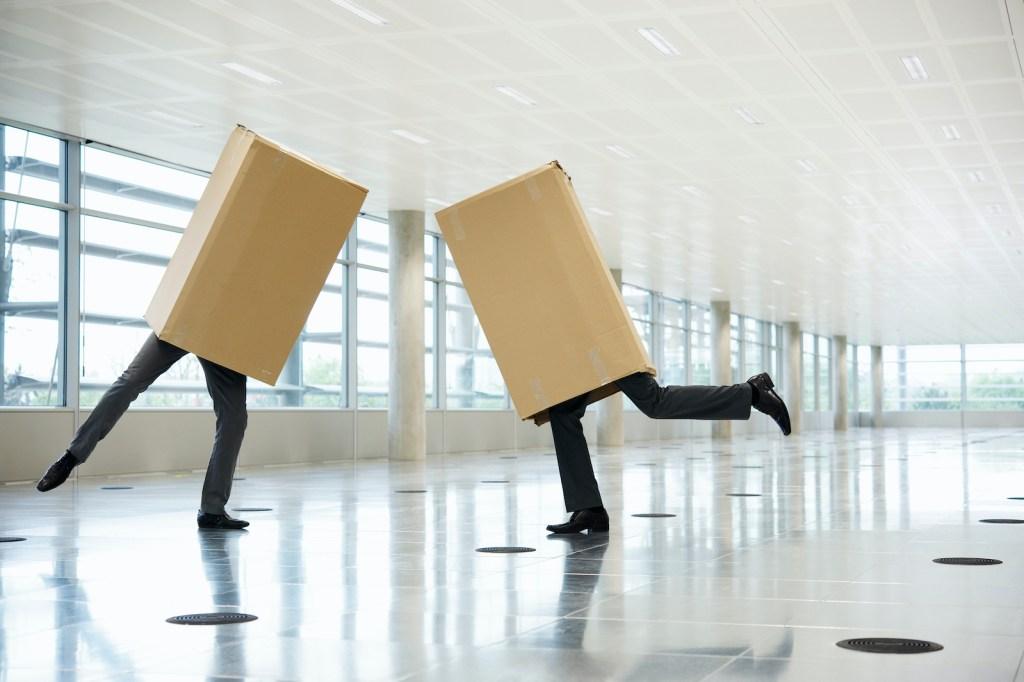 Portrait of two men in cardboard boxes