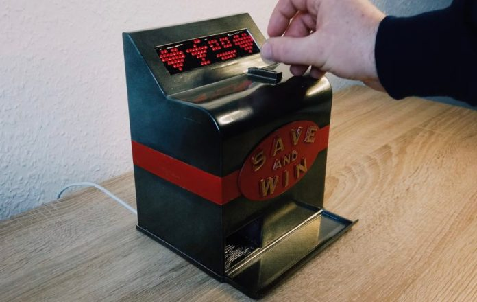 slot machine piggy bank makes saving your coins more fun hyperedge embed image