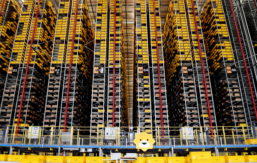 Express parcels sit stacked at a logistic base of e-commerce giant Suning before the 618 Shopping Festival