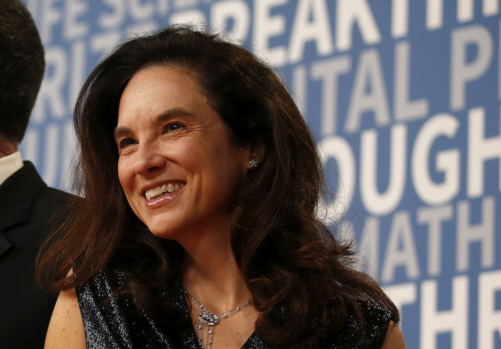 Caryn Marooney, right, vice president of technology communications at Facebook, poses for a picture on the red carpet for the 6th annual 2018 Breakthrough Prizes at Moffett Federal Airfield, Hangar One in Mountain View, Calif., on Sunday, Dec. 3, 2017. (N