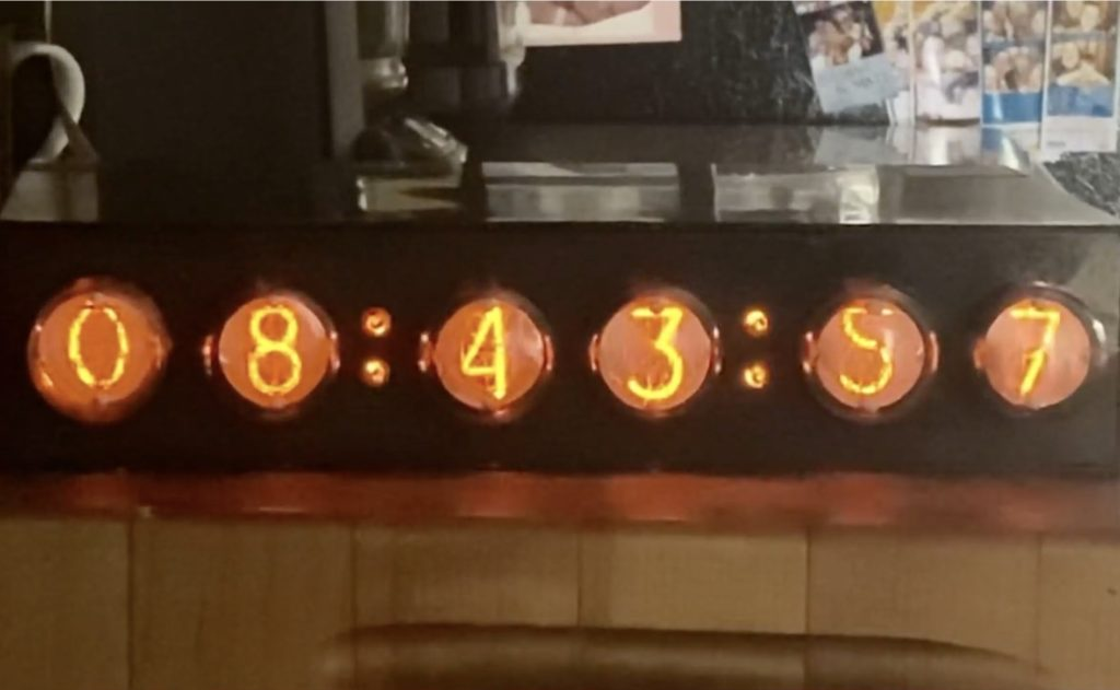 this nixie tube clock keeps the time and the cost down hyperedge embed image