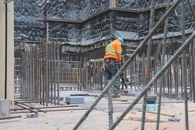 Rebar being tied together by hands