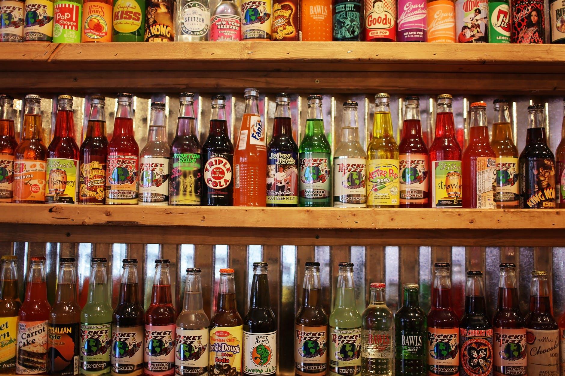 colorful bottles of soda pop on store shelf