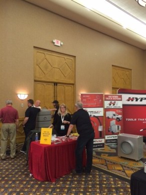hypervac employees setting up equipment at convention