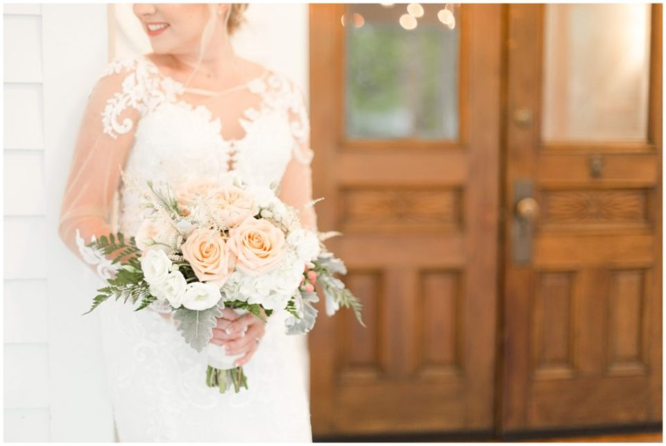 bridal session at ritchie hill venue in concord with big porch and wooden french doors