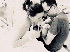 Claire & Jon holding their newborn Hypnobub
